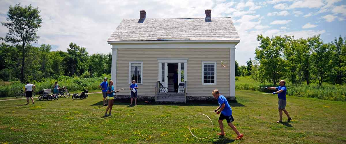 Children playing hoops in front of Historic Pierre Bottineau House