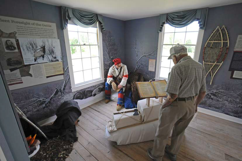 Man views display in historical house
