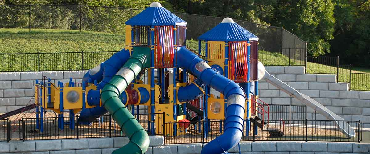 Play area with slides and climbing structures