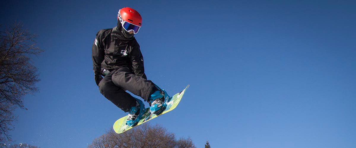 Snowboarder coming off a jump