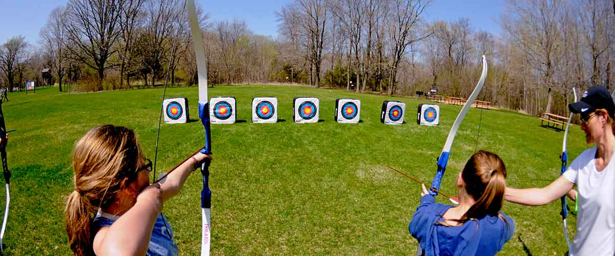 Children aiming for archery targets