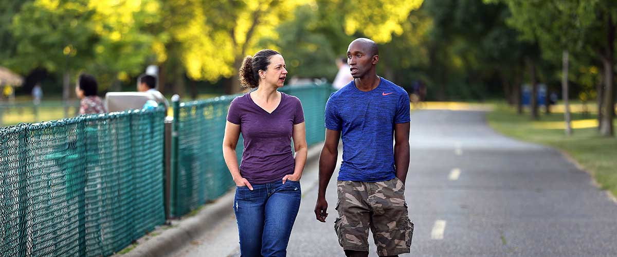 Couple walking on a paved trail