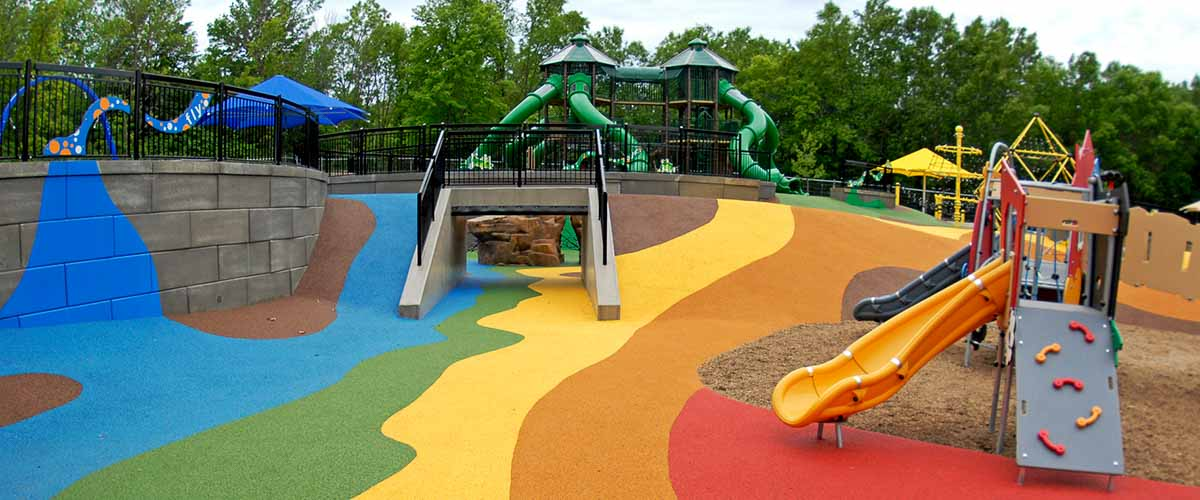 Colorful play area with slides and climbing strutures