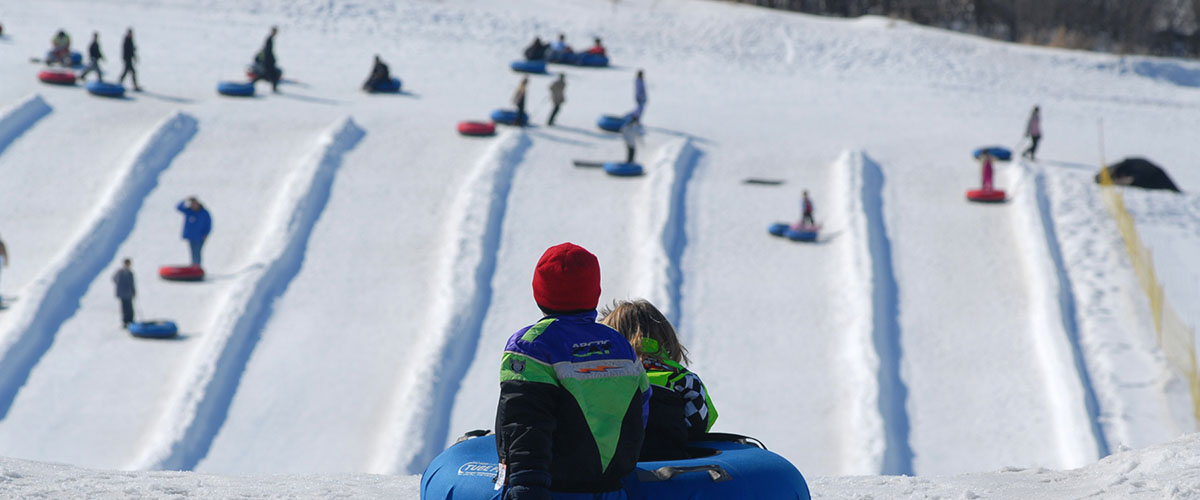 Children waiting at the top of the tubing hill