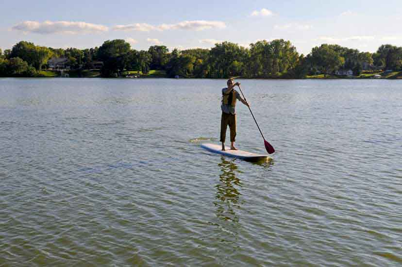 A man stands on a paddle board